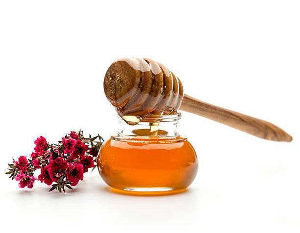 manuka flowers and honey jar